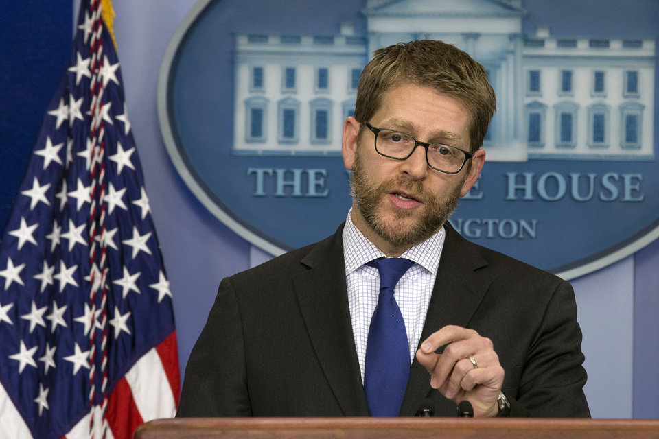 Photo - White House press secretary Jay Carney speaks during his daily news briefing, where he answers questions including on Iraq and Iran, at the White House in Washington, Monday, Jan. 13, 2014. (AP Photo/Jacquelyn Martin)