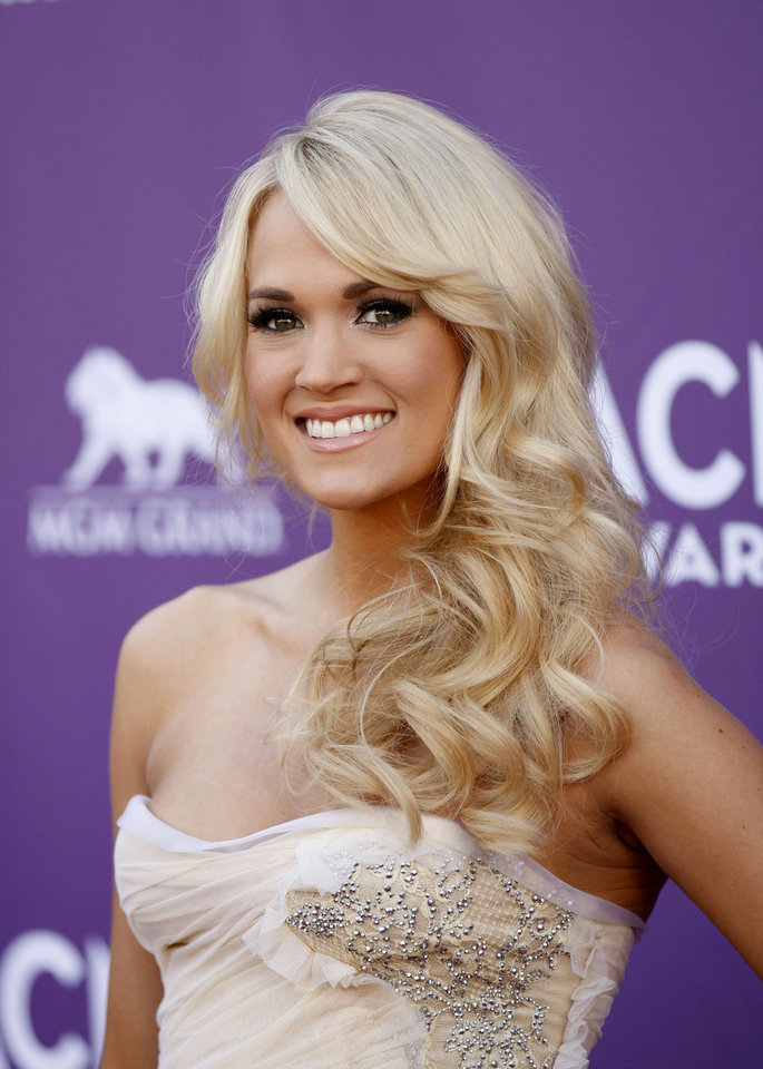 Carrie Underwood arrives at the 47th Annual Academy of Country Music Awards on Sunday, April 1, 2012 in Las Vegas. (AP Photo/Isaac Brekken)