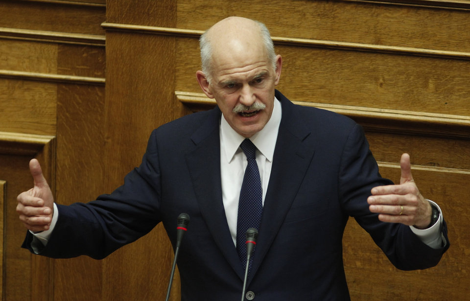 Greek Prime Minister George Papandreou speaks during a parliament session in Athens, Thursday, Nov. 3, 2011. Papandreou abandoned his explosive plan to put a European rescue deal to popular vote Thursday, keeping his government alive _ but passionate squabbling in Athens left the country\'s solvency in doubt and the eurozone in turmoil. Greek Prime Minister reversed course after a rebellion within his own Socialist party over the referendum, but ignored repeated calls to resign and call elections.(AP Photo/Petros Giannakouris) ORG XMIT: XPG118