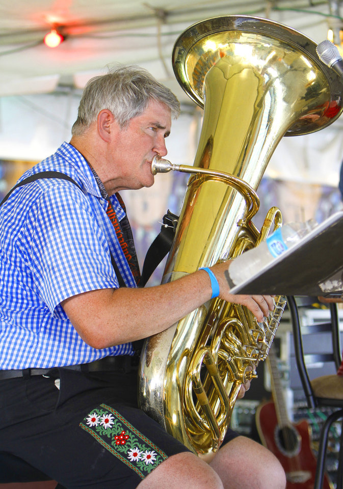 Photo - Mike Barker with the band Alpenfest plays his tuba during Oktoberfest in the Park in Choctaw, Monday, September 3, 2012. Photo By David McDaniel/The Oklahoman