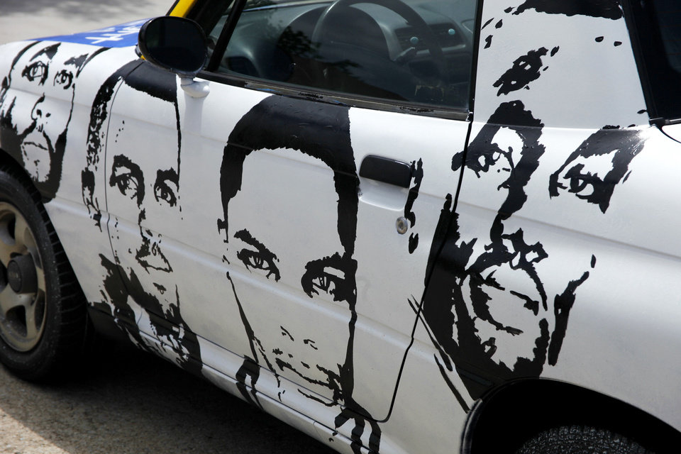 Drew Hooper painted his car with the faces of Thunder players. Faces from left: Daequan Cook, Thabo Sefolosha, Russell Westbrook and Serge Ibaka. Photo by Doug Hoke, The Oklahoman
