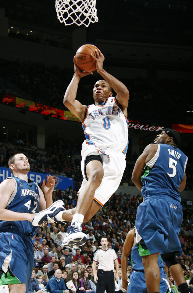 Photo - Oklahoma City's Russell Westbrook moves to the hoop between Kevin Love, left, and Craig Smith of Minnesota during the NBA basketball game between the Oklahoma City Thunder and the Minnesota Timberwolves at the Ford Center in Oklahoma City, Friday, Nov. 28, 2008. Minnesota won, 105-103. BY NATE BILLINGS, THE OKLAHOMAN ORG XMIT: KOD