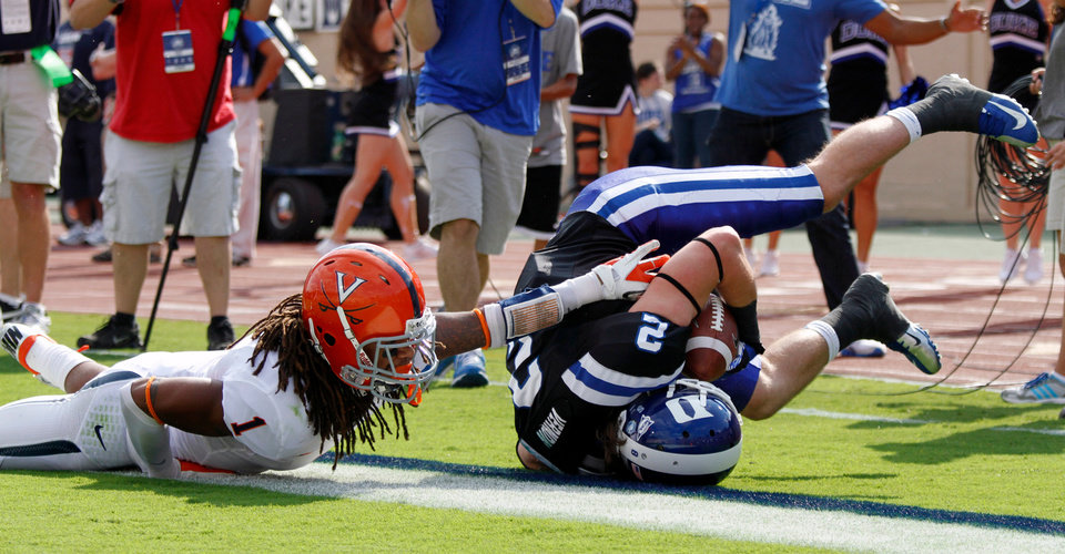 Duke wide receiver Conner Vernon (2) gets past Virginia's Demetrious Nicholson (1) for a touchdown during the first quarter of an ACC college football game at Wallace Wade Stadium in Durham, N.C. on Saturday, Oct. 6, 2012. (AP Photo/The News & Observer, Chris Seward)