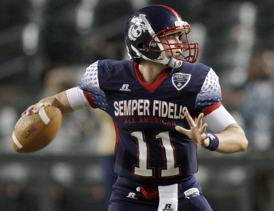 Wes Lunt throws during the Semper Fidelis All-American Bowl at Chase Field in Phoenix, Ariz., Tuesday, Jan. 3, 2012. Photo by Bryan Terry, The Oklahoman <strong>BRYAN TERRY</strong>