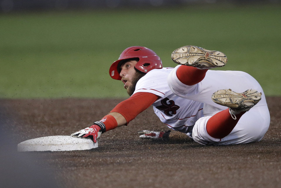 Photo - Louisiana Lafayette's Ryan Leonards reacts as he is caught stealing second base in the first inning of an NCAA college baseball tournament super regional game against Mississippi in Lafayette, La.,Sunday, June 8, 2014. (AP Photo/Gerald Herbert)