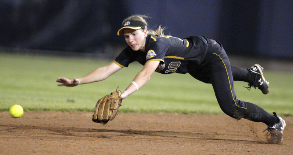 Missouri's Abby Vock (10) dives for a ball during the Women's College World Series game between Baylor and Missouri at the ASA Hall of Fame Stadium in Oklahoma City, Saturday, June 4, 2011. Photo by Sarah Phipps, The Oklahoman
