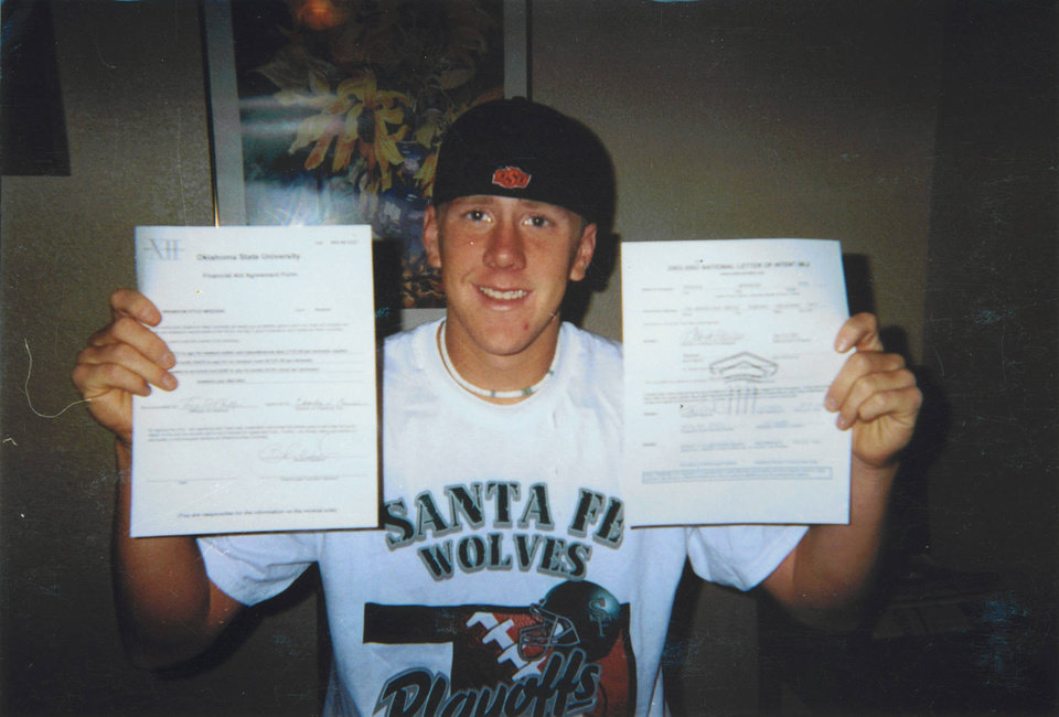 Photo - Brandon Weeden shows off his Letter of Intent to play baseball at Oklahoma State. PHOTO PROVIDED