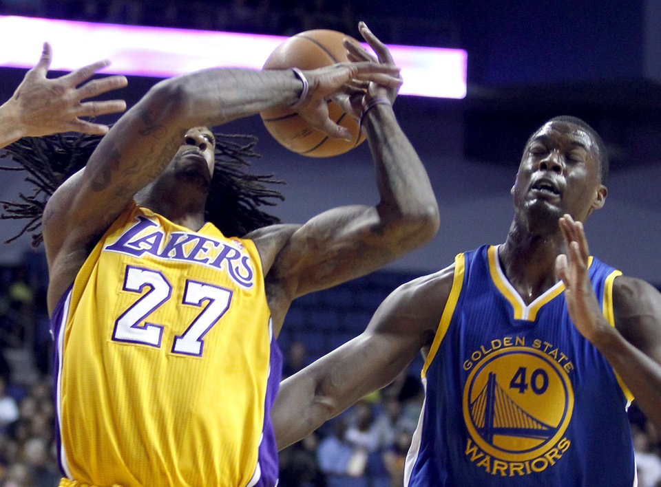 Photo - Los Angeles Lakers center Jordan Hill (27) loses the ball with Golden State Warriors forward Harrison Barnes, right, defending, in the first quarter during an NBA basketball preseason game Saturday, Oct. 5, 2013, in Ontario, Calif. (AP Photo/Alex Gallardo)