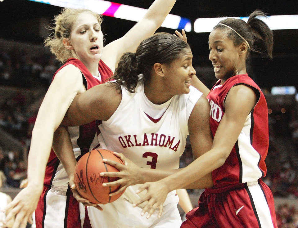 Stanford's Candice Wiggins, right, battles OU's Courtney Paris during their NCAA Regional semifinal game at the AT&T Center in San Antonio on March 25, 2006. Stanford defeated the Sooners, 88-74.  By Nate Billings, The Oklahoman Archive