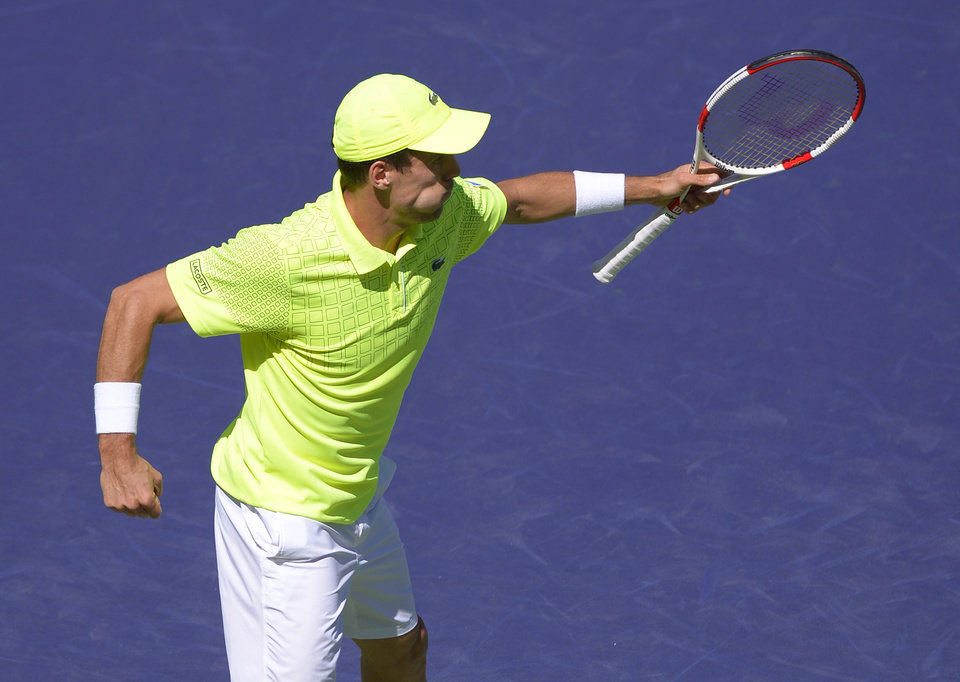 Photo - Roberto Bautista Agut, of Spain, celebrates his 4-6, 6-2, 6-4 victory over Tomas Berdych, of the Czech Republic, in a match at the BNP Paribas Open tennis tournament on Sunday, March 9, 2014, in Indian Wells, Calif. (AP Photo/Mark J. Terrill)