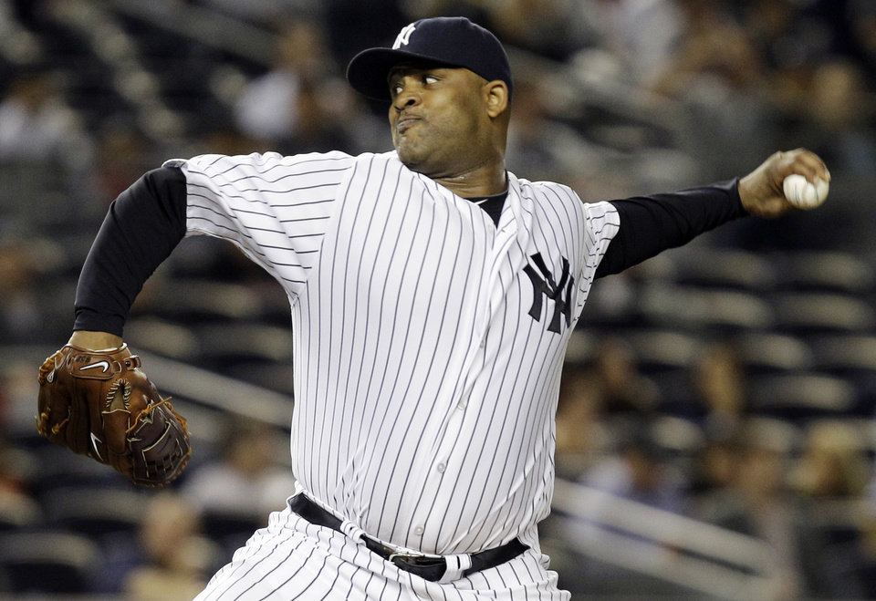 Photo -   New York Yankees starting pitcher CC Sabathia delivers against the Boston Red Sox in the second inning of their baseball game at Yankee Stadium in New York, Monday, Oct. 1, 2012. (AP Photo/Kathy Willens)