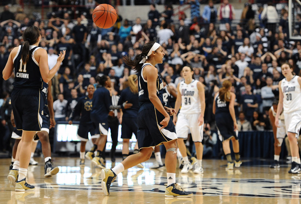 Notre Dame's Skylar Diggins, center, reacts at the end of an NCAA college basketball game against Connecticut in Storrs, Conn., Saturday, Jan. 5, 2013. Notre Dame won 73-72. (AP Photo/Jessica Hill)