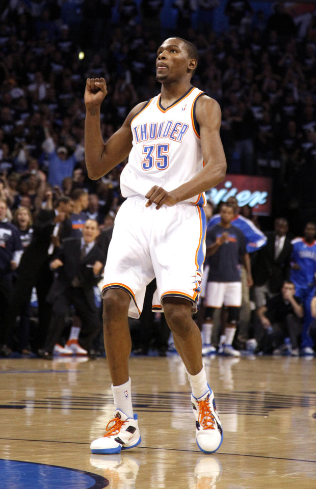 Photo - Oklahoma City's Kevin Durant (35) reacts after making last basket during the NBA basketball game between the Denver Nuggets and the Oklahoma City Thunder in the first round of the NBA playoffs at the Oklahoma City Arena, Wednesday, April 27, 2011. Photo by Sarah Phipps, The Oklahoman
