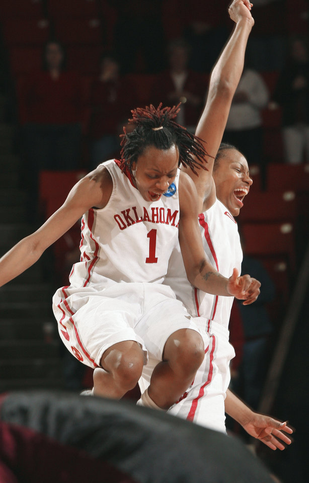 Photo - Nyeshia Stevenson, left, Amanda Thompson and OU advance to the women's Sweet 16.  Photo by Steve Sisney, The Oklahoman