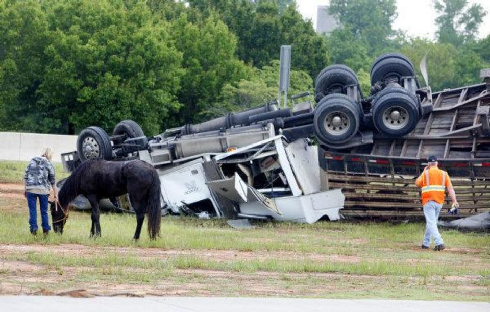 Photo - A semi hauling a stock trailer loaded with horses overturned west bound on the Turner Turnpike at the I-35 exit in Oklahoma City early Tuesday morning, May 18, 2010. The driver fell asleep. Photo by Paul B. Southerland, The Oklahoman ORG XMIT: KOD