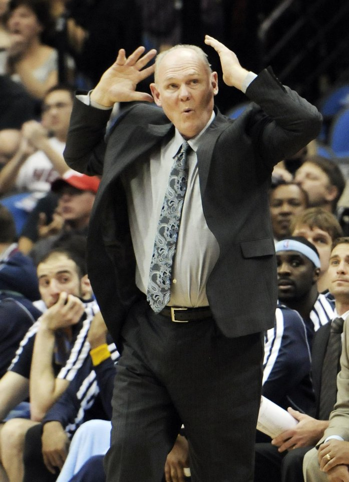 Photo -   Denver Nuggets head coach George Karl reacts in the second half of an NBA basketball game against the Minnesota Timberwolves, Wednesday, Nov. 21, 2012, in Minneapolis. The Nuggets won 101-94. (AP Photo/Jim Mone)
