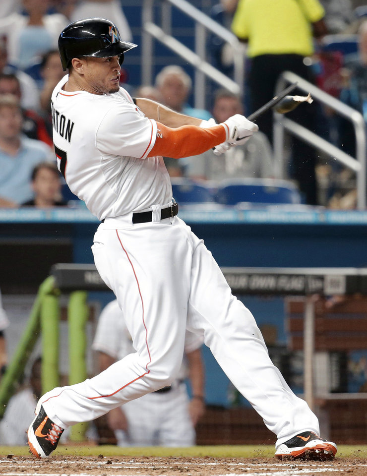 Photo - Miami Marlins' Giancarlo Stanton breaks his bat as he lines out to Tampa Bay Rays shortstop Yunel Escobar during the fourth inning of an interleague baseball game, Tuesday, June 3, 2014, in Miami. (AP Photo/Lynne Sladky)
