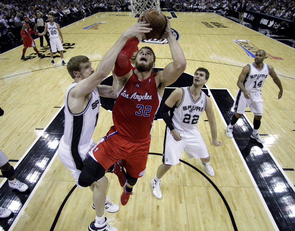 Photo -   Los Angeles Clippers' Blake Griffin (32) is blocked by San Antonio Spurs' Matt Bonner, left, during the first quarter of Game 2 of an NBA basketball Western Conference semifinal playoff series on Thursday, May 17, 2012, in San Antonio. (AP Photo/Eric Gay)