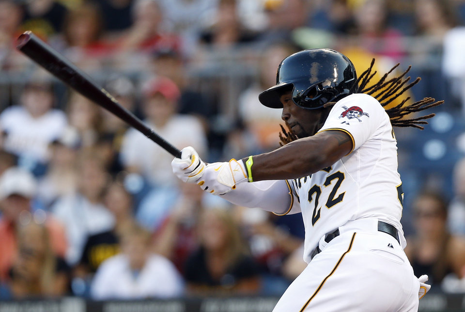 Photo - Pittsburgh Pirates' Andrew McCutchen swings in his first at bat in the first inning of a baseball game against the Atlanta Braves on Tuesday, Aug. 19, 2014, in Pittsburgh. It was McCutchen's first game back in the lineup since going on the injured reserve list. McCutchen struck out in the at bat. (AP Photo/Keith Srakocic)