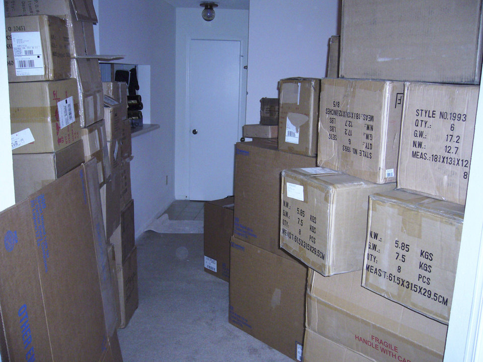 Photo - Merchandise stacked to the ceiling in Keith Winter's one-bedroom apartment about 2004.   - Provided