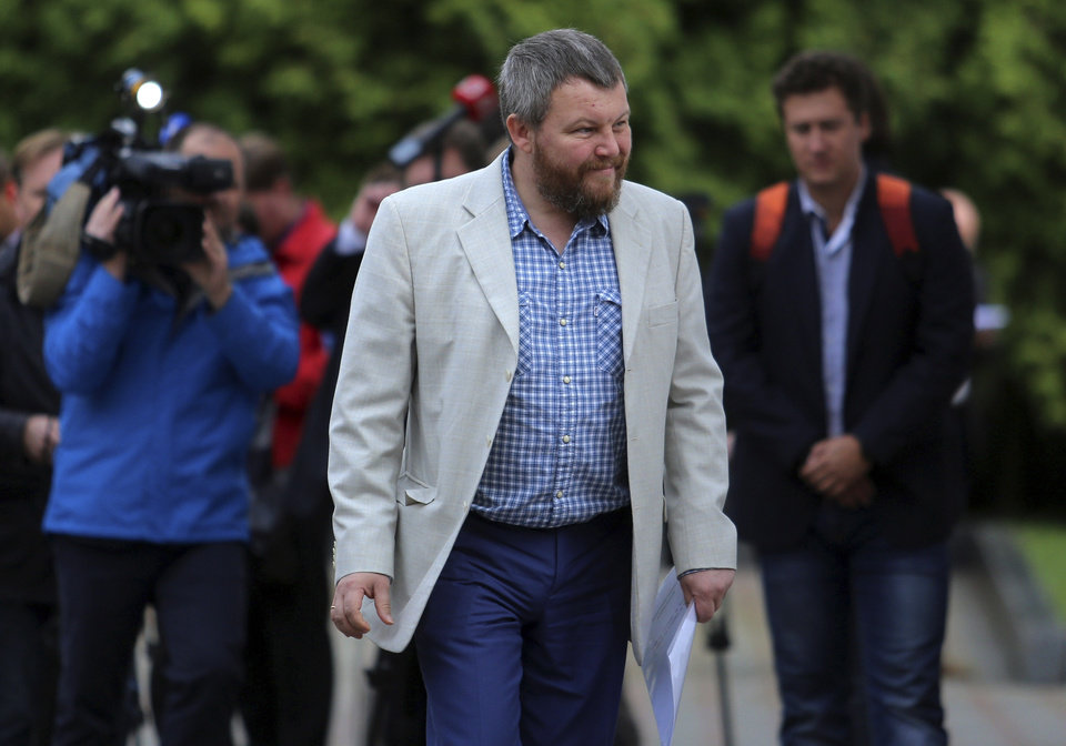 Photo - Pro-Russian rebel leader from eastern Ukraine Andrei Purgin arrives for the talks in Minsk, Belarus, Monday Sept. 1, 2014. A so-called contact group is meeting for talks in Minsk, the Belarusian capital, to reach an agreement on a cease-fire. The group, which last met in late July, includes representatives from Ukraine, Russia and the Organization for Security and Cooperation in Europe. (AP Photo)