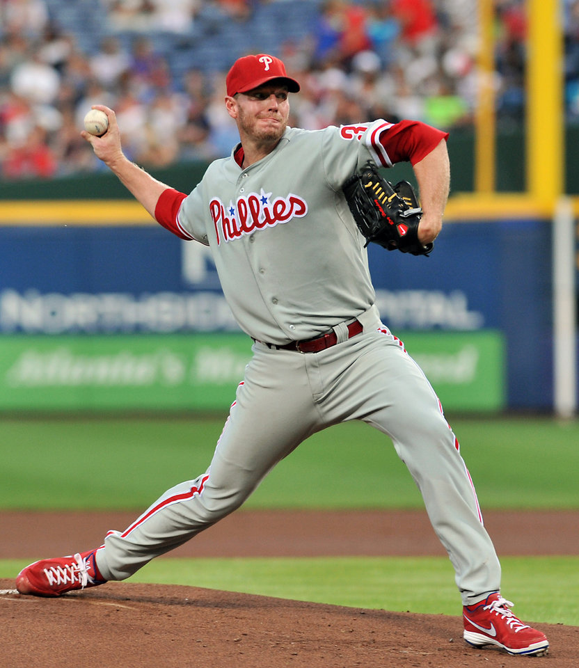 Photo -   Philadelphia Phillies starter Roy Halladay delivers to the Atlanta Braves during the first inning of a baseball game on Friday, Aug. 31, 2012, at Turner Field in Atlanta. (AP Photo/Gregory Smith)