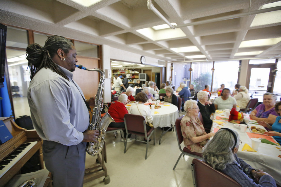 Photo -  Boris Connally plays his saxophone for patrons at the Danforth Senior Center. [PHOTO BY STEVE GOOCH, THE OKLAHOMAN ARCHIVES]