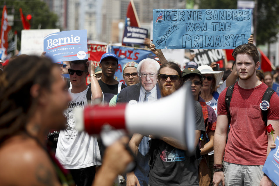 Photo - Supporters of Sen. Bernie Sanders, I-Vt., march during a protest in downtown Philadelphia, Monday, July 25, 2016, on the first day of the Democratic National Convention. (AP Photo/John Minchillo)