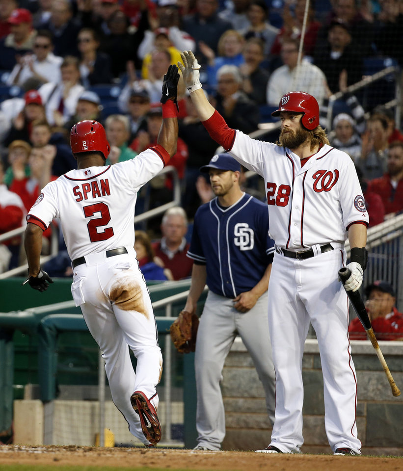 Photo - Washington Nationals' Denard Span (2) celebrates his score with Jayson Werth (28) as San Diego Padres starting pitcher Eric Stults, center, looks on during the third inning of a baseball game at Nationals Park, Thursday, April 24, 2014, in Washington. (AP Photo/Alex Brandon)
