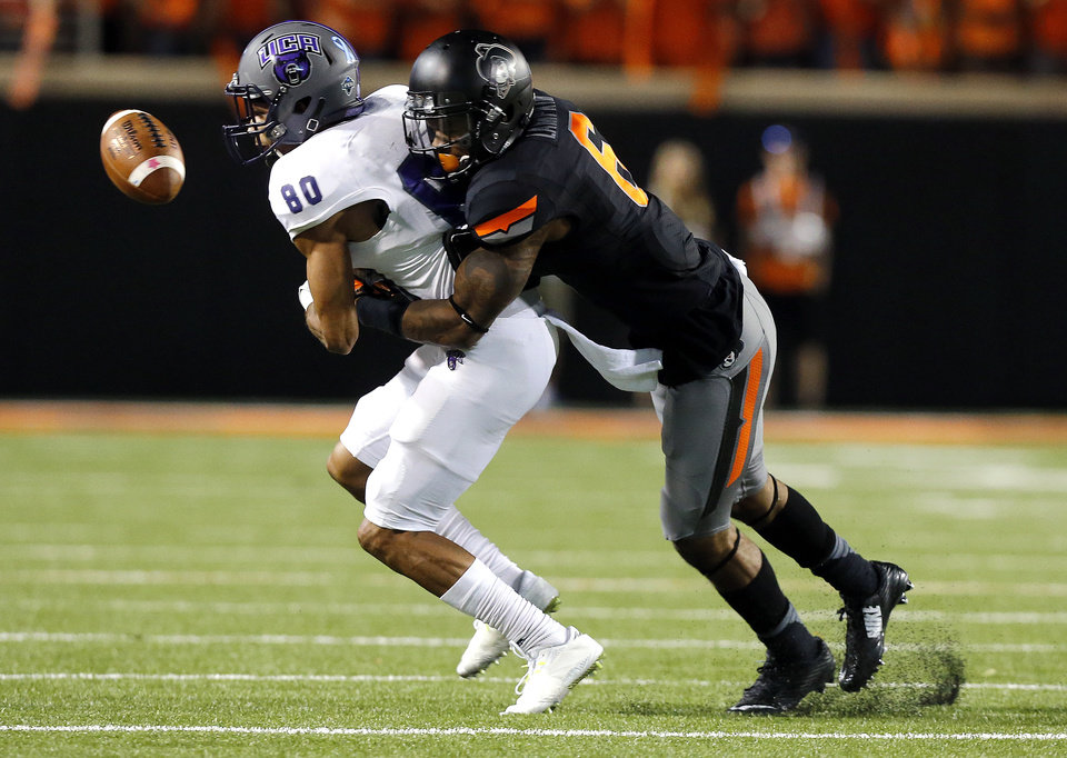 Photo - Oklahoma State's Ashton Lampkin (6) forces Central Arkansas's Blake Gardner (80) to drop a pass in the fourth quarter during the college football game between the Oklahoma State Cowboys (OSU) and the Central Arkansas Bears at Boone Pickens Stadium in Stillwater, Okla., Saturday, Sept. 12, 2015. Photo by Sarah Phipps, The Oklahoman