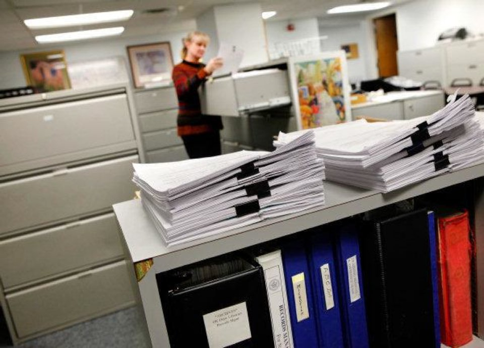 Photo - Various campaign finance reports awaiting filing were stacked on a cabinet March 10 in the Ethics Commission office in the basement of the Capitol.  JIM BECKEL