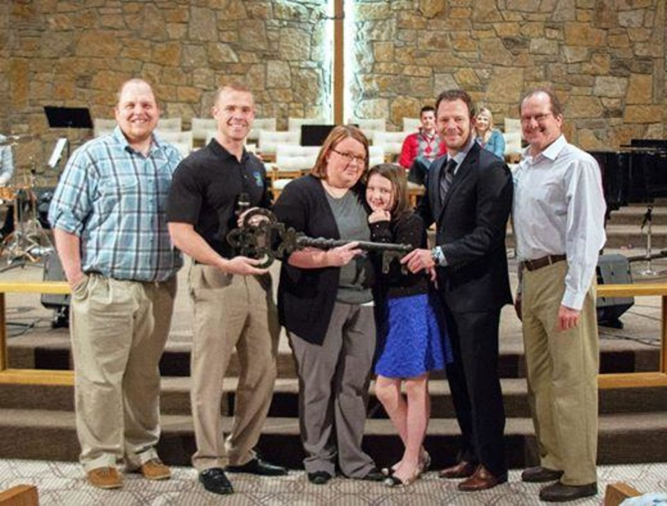 Photo -  From left, the Rev. Jerrod Nunn, Cody Bobay, Karissa and Jessica Smith, Dusty Boren and the Rev. Steve Chiles, senior pastor of Shartel Church of God, pose for a picture after Bobay's Lose to Serve organization announced that the Smiths would be the recipients of a new home. Photo provided
