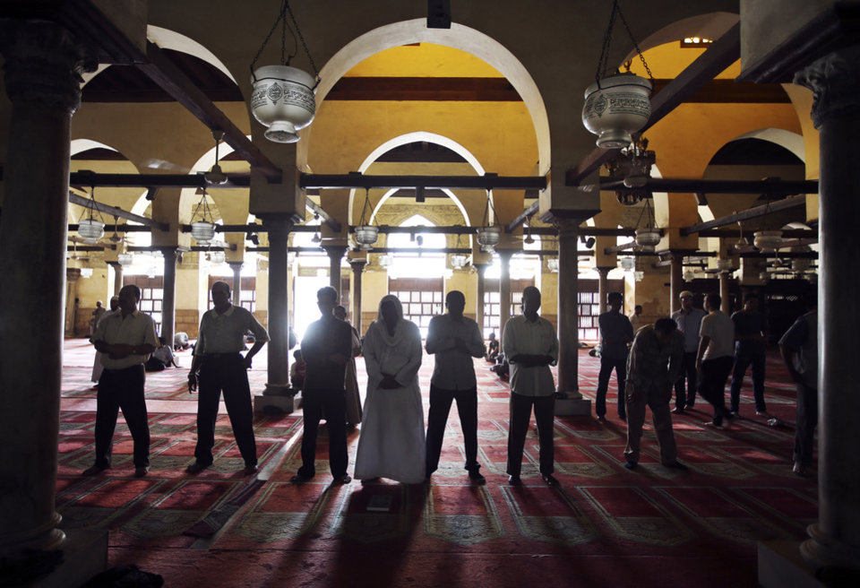 Photo - Egyptian men attend the afternoon prayer at al-Azhar mosque during the Muslim holy month of Ramadan in Cairo, Egypt, Sunday, July 14, 2013. Ramadan is traditionally a time of reflection and prayer, and observant Muslims are expected to abstain during daylight hours from food, drink, smoking and sex to focus on spirituality, good deeds and charity. (AP Photo/Hussein Malla)