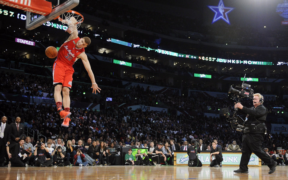 Photo - Los Angeles Clippers' Blake Griffin dunks during the Slam Dunk Contest at the NBA basketball All-Star weekend, Saturday, Feb. 19, 2011, in Los Angeles.  (AP Photo/Mark J. Terrill)