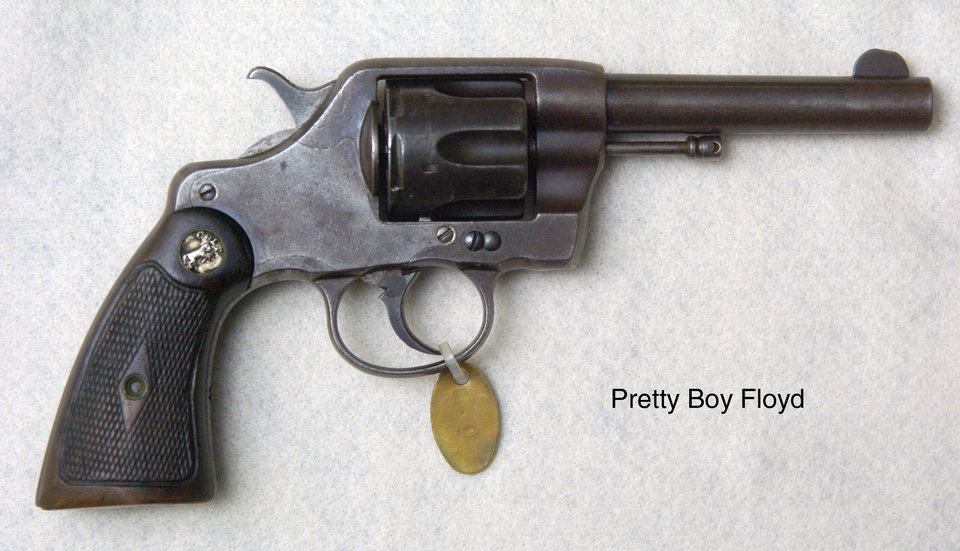 Photo - Claremore, Okla. 6/14/05     OUTLAW, OUTLAWS, GUN, GUNS, HANDGUN: One of Pretty Boy Floyd's handguns on display at the J.M. Davis Arms & Historical Museum. By Paul Hellstern/The Oklahoman
