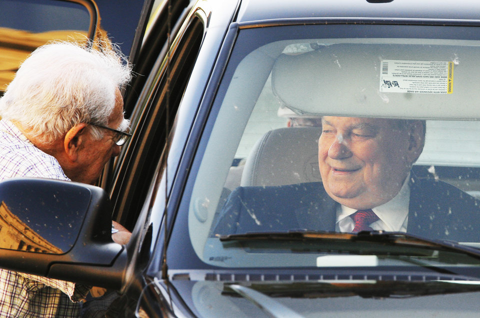 Photo - Gene Stipe, right, sits in a vehicle before his hearing in the Federal Court House in Muskogee, Tuesday, Auguest 28, 2007.  BY DAVID MCDANIEL, THE OKLAHOMAN. ORG XMIT: KOD