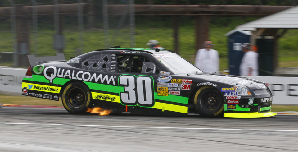 Photo -   Nelson Piquet Jr., (30) races through a turn during the NASCAR Nationwide Series Sargento 200 auto race at Road America in Elkhart Lake, Wis, Saturday, June, 23, 2012. Piquet Jr. went on to win the race. (AP Photo/Jeffrey Phelps)