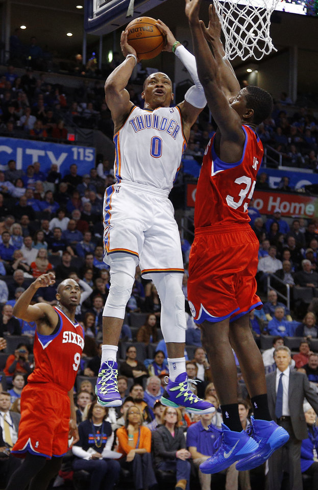 Oklahoma City\'s Russell Westbrook (0) goes to the basket beside Philadelphia\'s Henry Sims (35) during an NBA basketball game between the Oklahoma City Thunder and the Philadelphia 76ers at Chesapeake Energy Arena in Oklahoma City, Tuesday, March 4, 2014. Oklahoma City won 125-92. Photo by Bryan Terry, The Oklahoman
