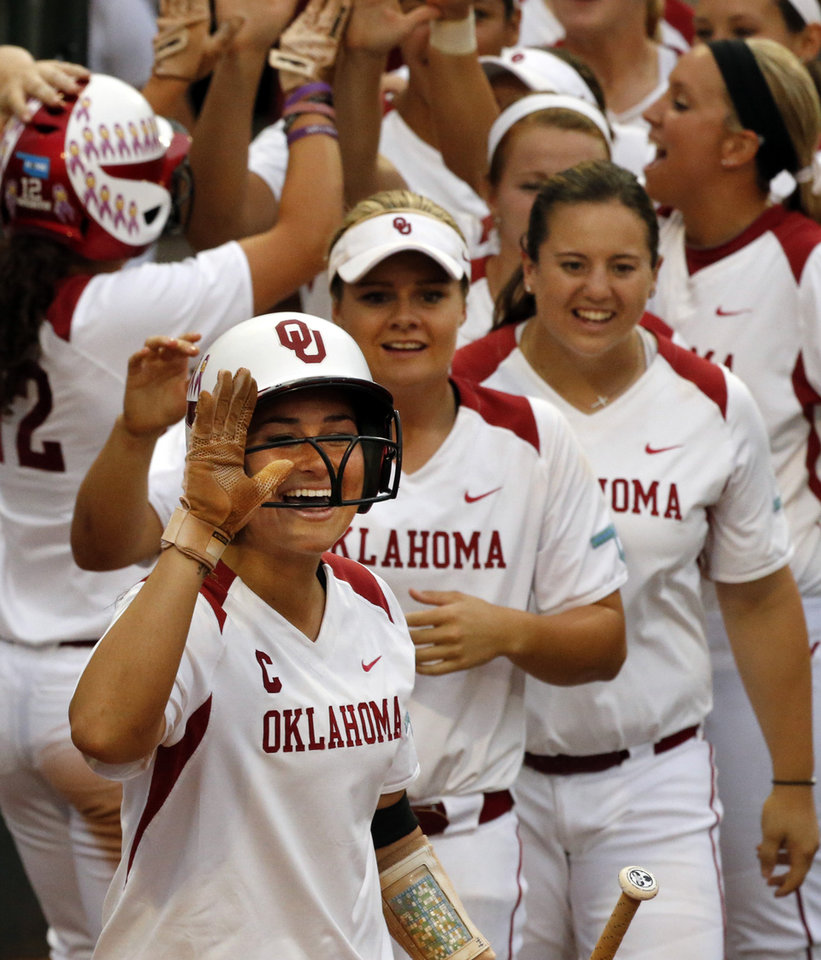 Photo - Sooner Lauren Chamberlain and teammates  celebrate a run by Callie Parsons as the University of Oklahoma Sooner (OU) softball team plays Tennessee in the first game of the NCAA super regional at Marita Hynes Field on May 23, 2014 in Norman, Okla. Photo by Steve Sisney, The Oklahoman