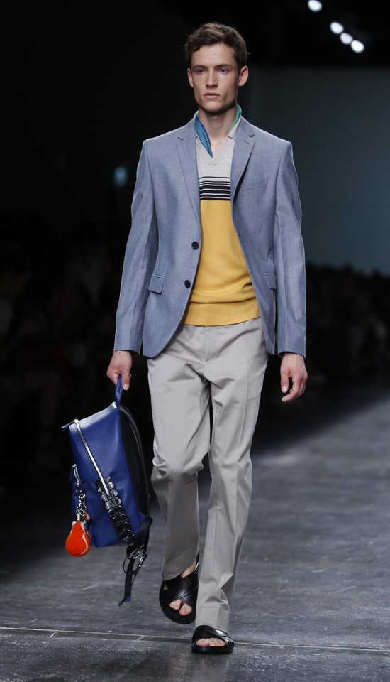 Photo - A models wears a creation for Fendi men's Spring-Summer 2015 collection, part of the Milan Fashion Week, unveiled in Milan, Italy, Monday, June 23, 2014. (AP Photo/Luca Bruno)