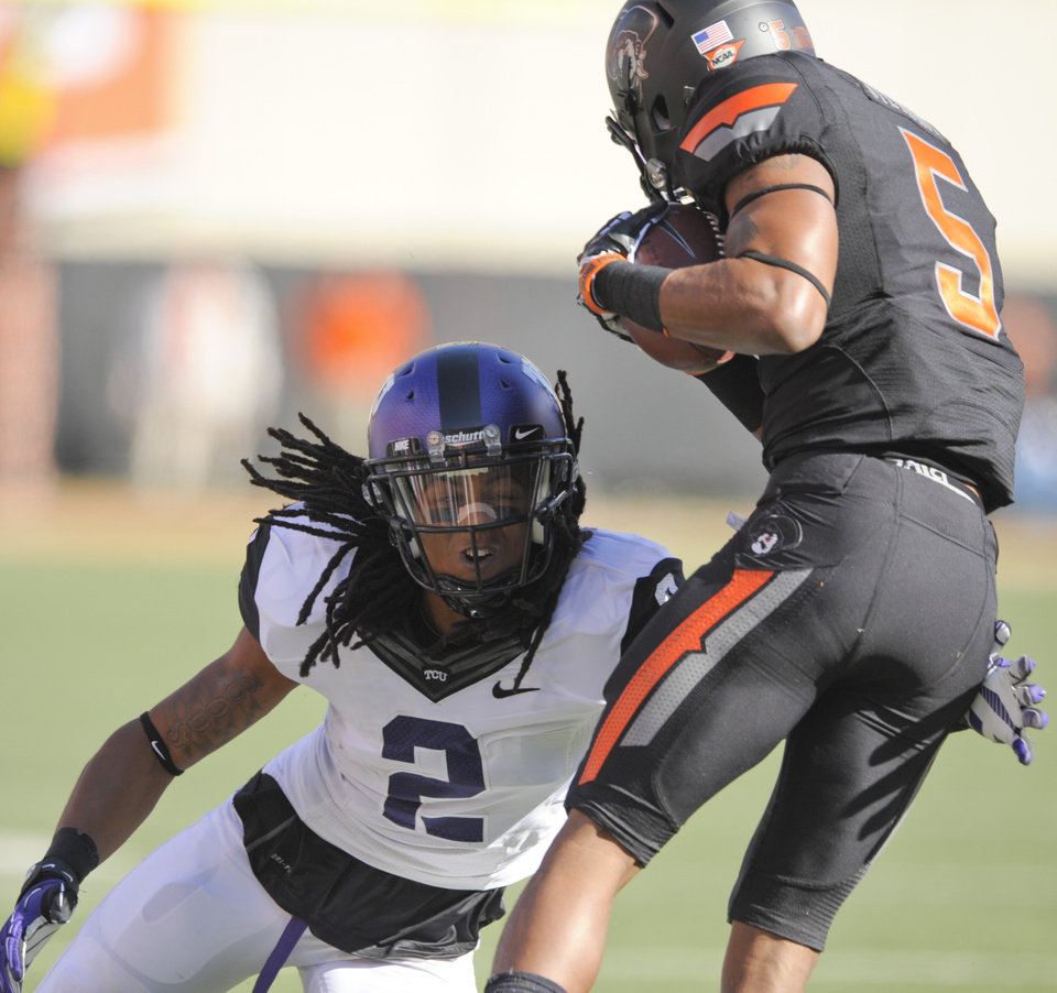 Photo -   TCU corner back Jason Verrett (2), tackles Oklahoma State receiver Josh Stewart (5) during the first half of an NCAA college football game in Stillwater, Okla., Saturday, Oct. 27, 2012.(AP Photo/Brody Schmidt)