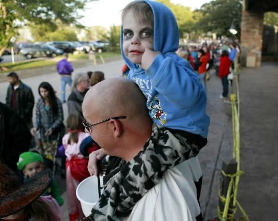 Zavior Jones, 2, of Piedmont, rides on his father Benjamin Jones' shoulders as they wait in a line before Haunt the Zoo at the Oklahoma City Zoo in Oklahoma City on Sunday, Oct. 30, 2011. Photo by John Clanton, The Oklahoman Archives