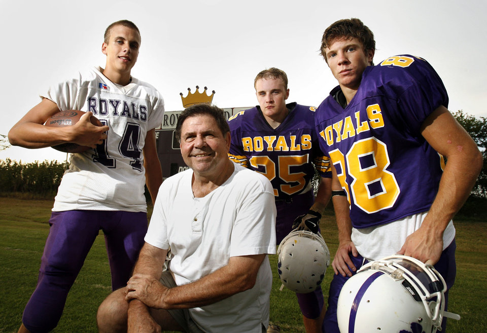 HIGH SCHOOL FOOTBALL: Head coach Brooks Mosier poses with quarterback Parker Burnett, running back Bryan Owen, and wide receiver Taylor Daniels at Community Christian School on Tuesday, Sept. 18, 2007, in Norman, Okla.   By STEVE SISNEY, The Oklahoman  ORG XMIT: KOD