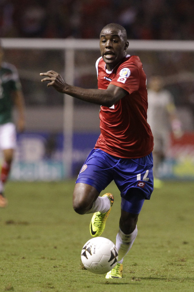 Photo - FILE - In this Oct. 15, 2013, file photo, Costa Rica's Joel Campbell controls the ball during a 2014 World Cup qualifying soccer match against Mexico in San Jose, Costa Rica. The Costa Rican squad will face Uruguay, England and Italy in the Brazilian northeastern city of Fortaleza. (AP Photo/Moises Castillo, File)