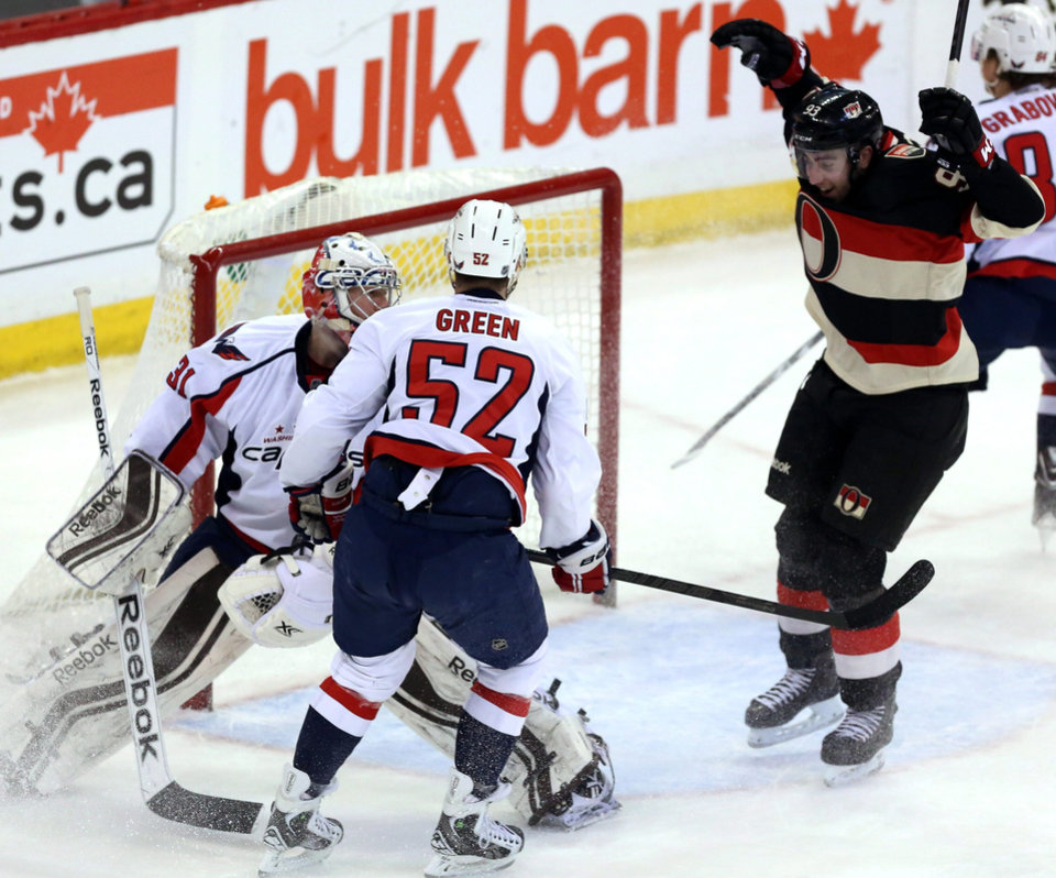 Ottawa Senators' Mika Zibanejad (93)celebrates his goal as Washington Capitals goaltender Philipp Grubauer (31) and Mike Green (52) look on during first period NHL hockey action in Ottawa, Ontario, on Monday, Dec. 30, 2013. (AP Photo/The Canadian Press, Fred Chartrand)