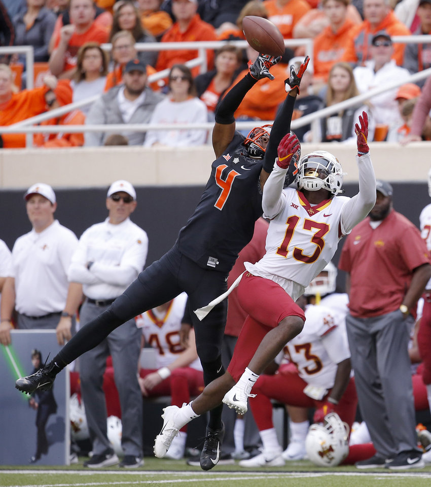 Photo -  Oklahoma State cornerback A.J. Green broke up this pass to Iowa State's Josh Johnson, but Green was called for interference on the play, one of 11 penalties against him this season. [PHOTO BY SARAH PHIPPS, THE OKLAHOMAN]