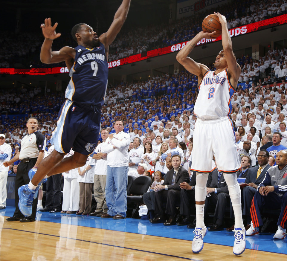 Photo - Oklahoma City's Thabo Sefolosha shoots the ball as Memphis' Tony Allen defends during Game 2 in the second round of the NBA playoffs between the Oklahoma City Thunder and the Memphis Grizzlies at Chesapeake Energy Arena In Oklahoma City, Tuesday, May 7, 2013. Photo by Bryan Terry, The Oklahoman