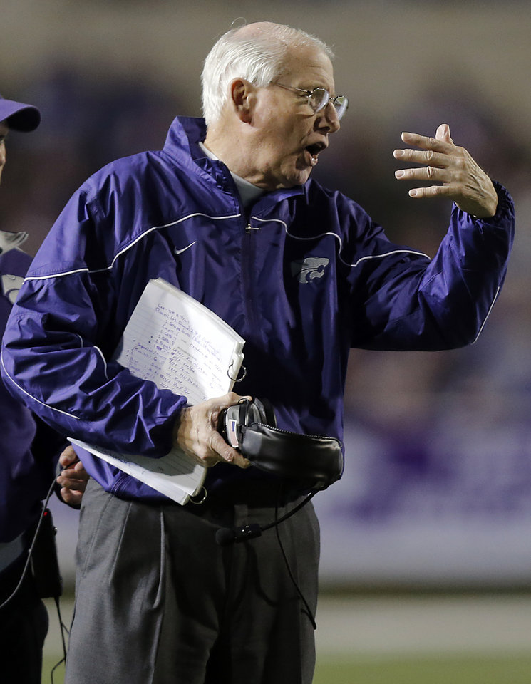 Photo - Bill Snyder motions to his team during the college football game between the Oklahoma State University Cowboys (OSU) and the Kansas State University Wildcats (KSU) at Bill Snyder Family Football Stadium on Saturday, Nov. 1, 2012, in Manhattan, Kan. Photo by Chris Landsberger, The Oklahoman