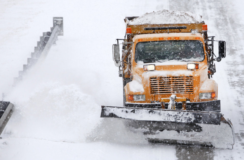 Photo - A snow plow clears a section of I-35 near Guthrie , February  9 , 2011. Photo by Steve Gooch, The Oklahoman