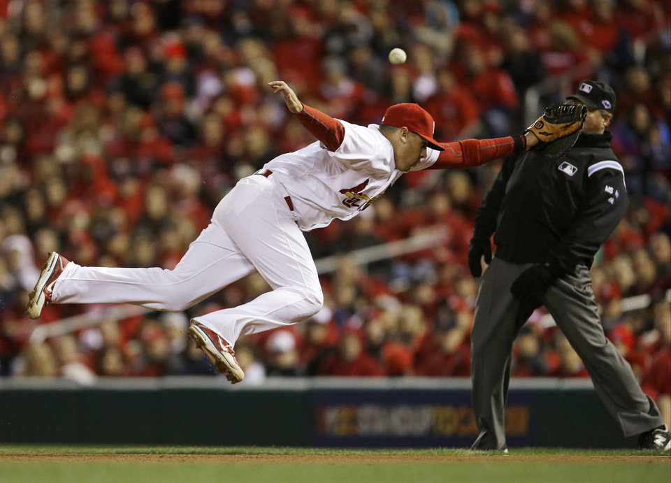 Photo -   St. Louis Cardinals first baseman Allen Craig can't come up with a foul ball hit by San Francisco Giants' Pablo Sandoval during the eighth inning of Game 5 of baseball's National League championship series, Friday, Oct. 19, 2012, in St. Louis. (AP Photo/Jeff Roberson)